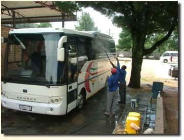 Bus washing and cleaning system