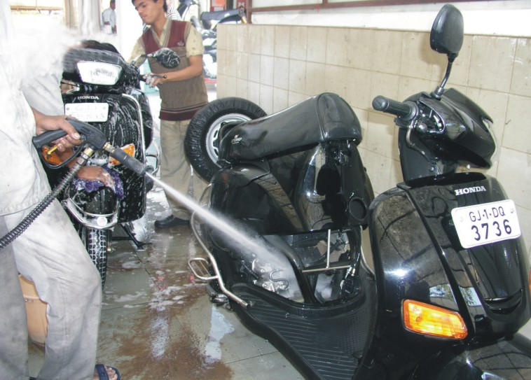 Two wheeler cleaning